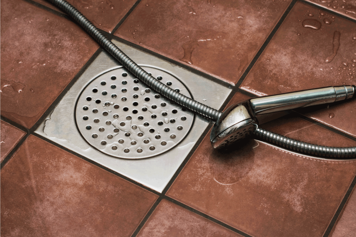 Shower drain and shower head, brown shower room floor tile