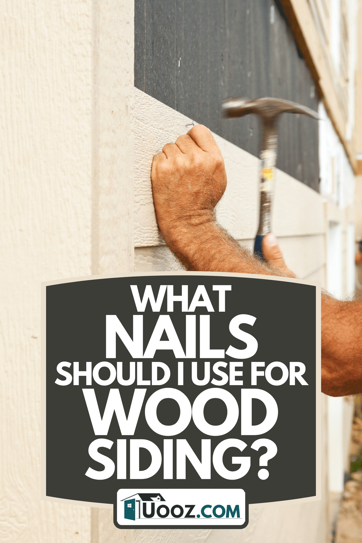 A construction worker using hammer installing siding onto a tar paper covered exterior house wall, What Nails Should I Use For Wood Siding?