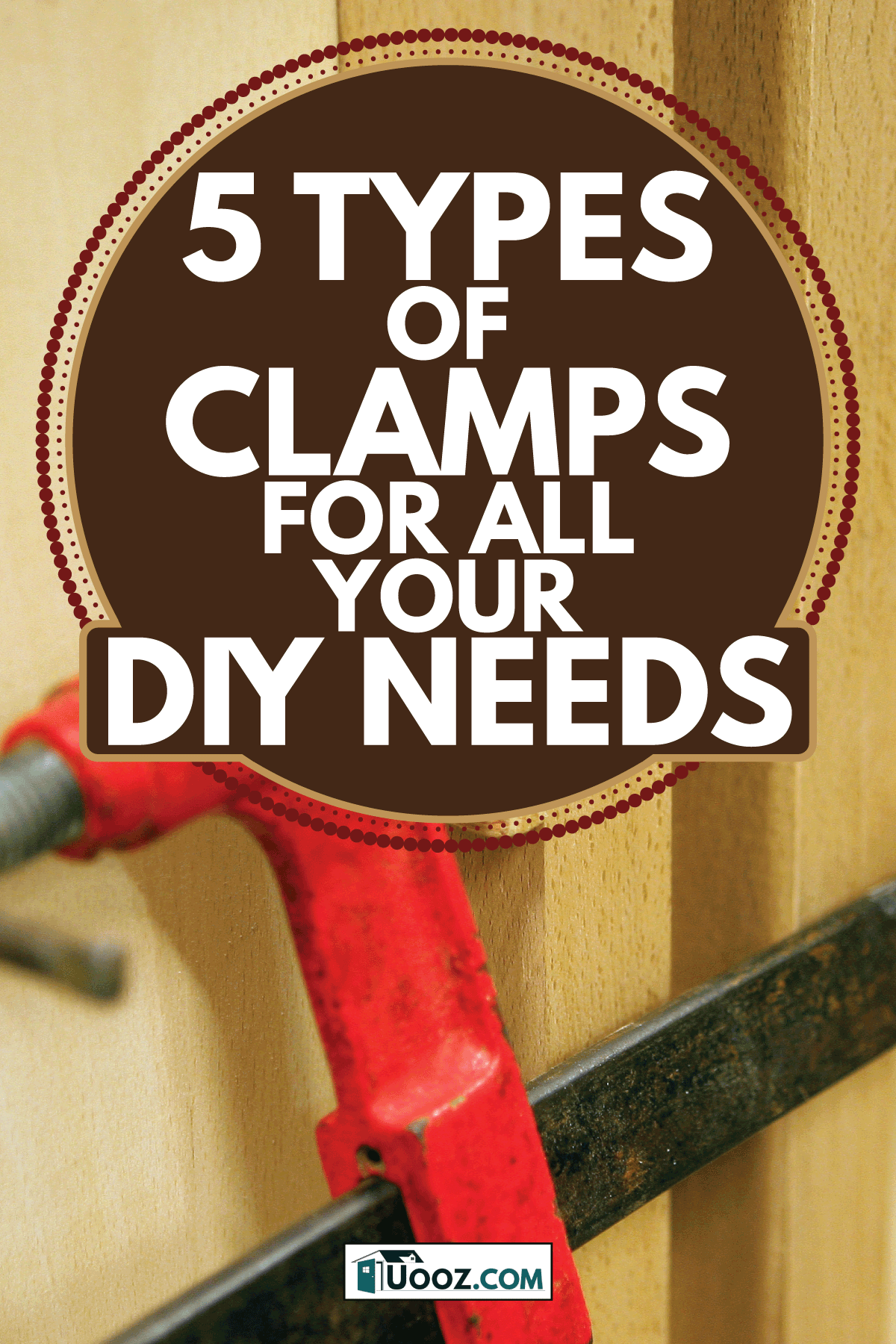 Wooden door with a red bar clamp attached to it. 5 Types Of Clamps For All Your DIY Needs