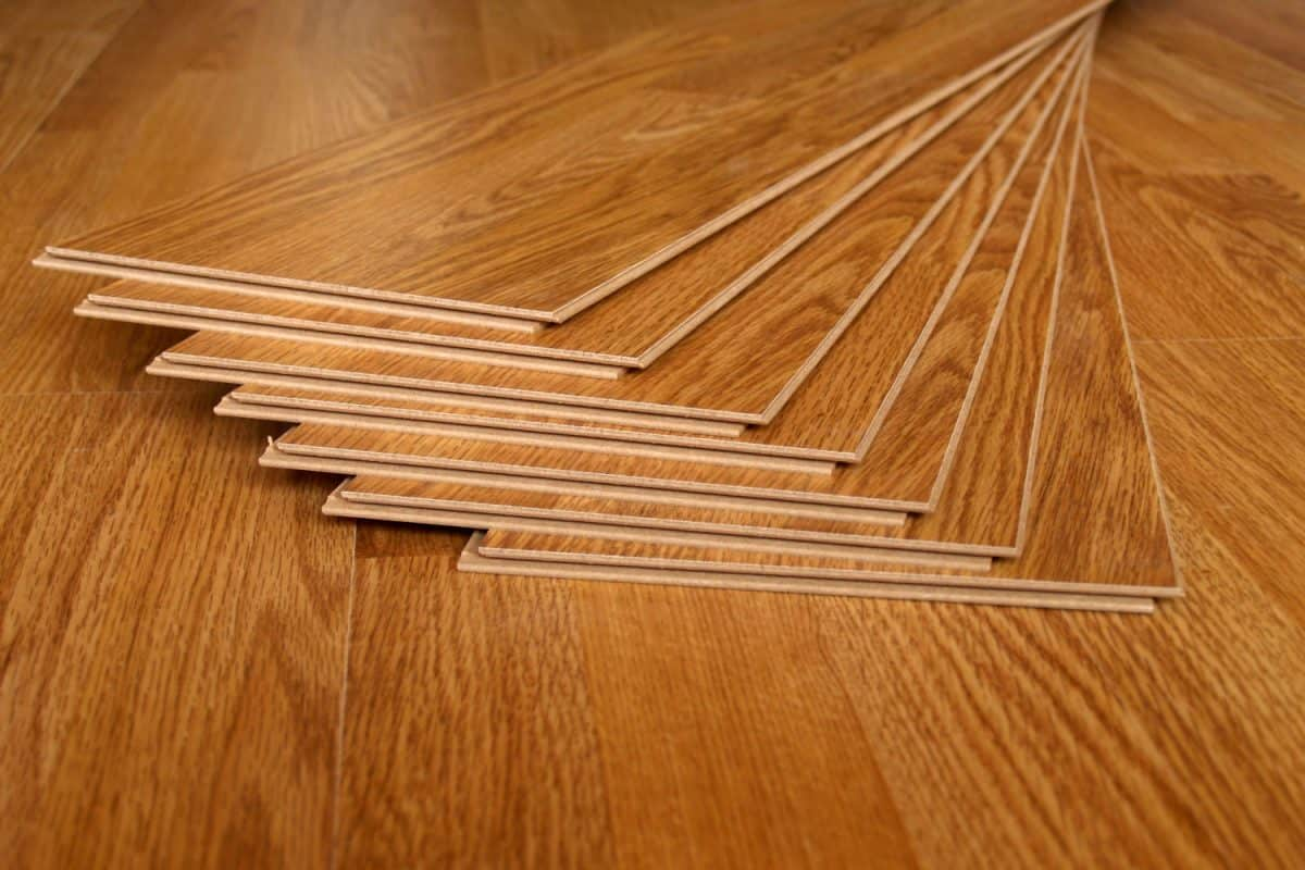 Wooden laminated tiles on top of laminated flooring