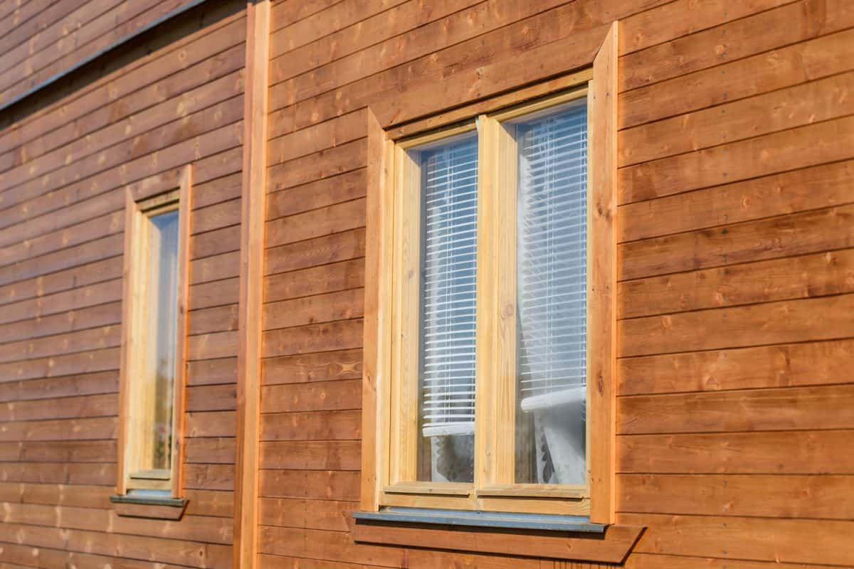Wooden window and a wooden siding