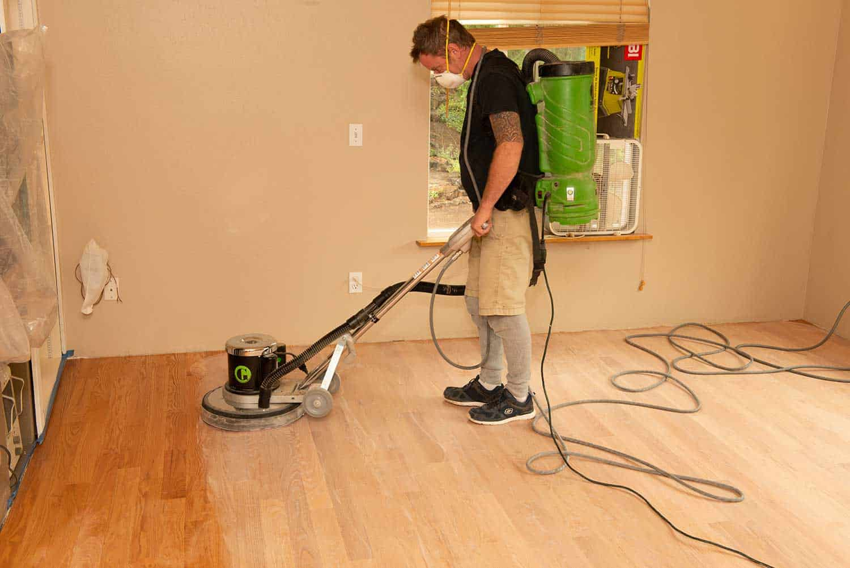 A professional burnishing hardwood floor