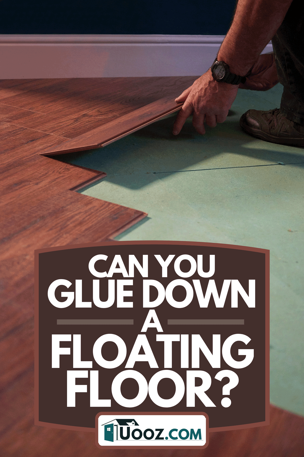Workman laying a piece of new laminate flooring, Can You Glue Down A Floating Floor?