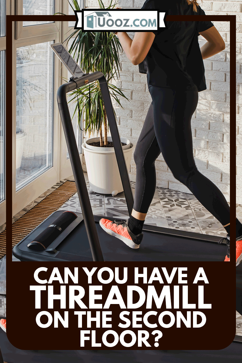 Young woman jogging on the modern compact treadmill at her home at room with big windows, Can You Have A Treadmill On The Second Floor?