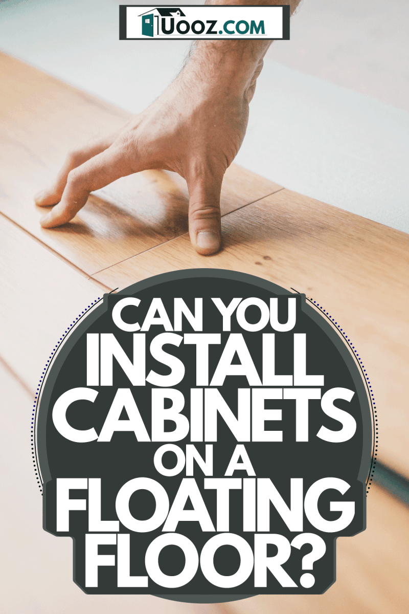 A tile setter installing a floating floor tile, Can You Install Cabinets On A Floating Floor?