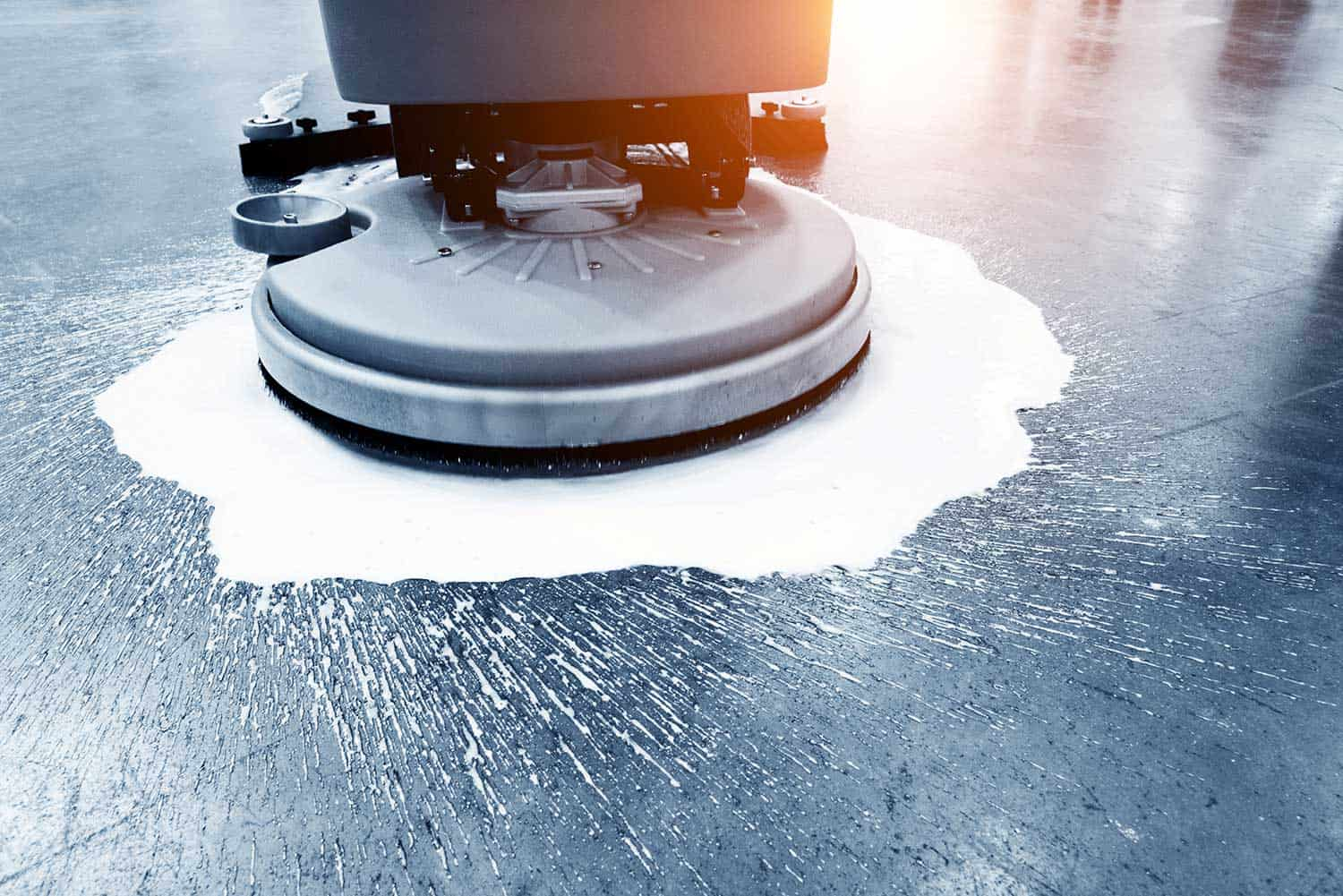 Cleaning floor with buffing machine