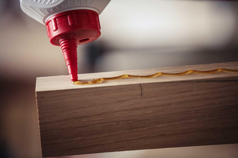 Close up of glue on wood