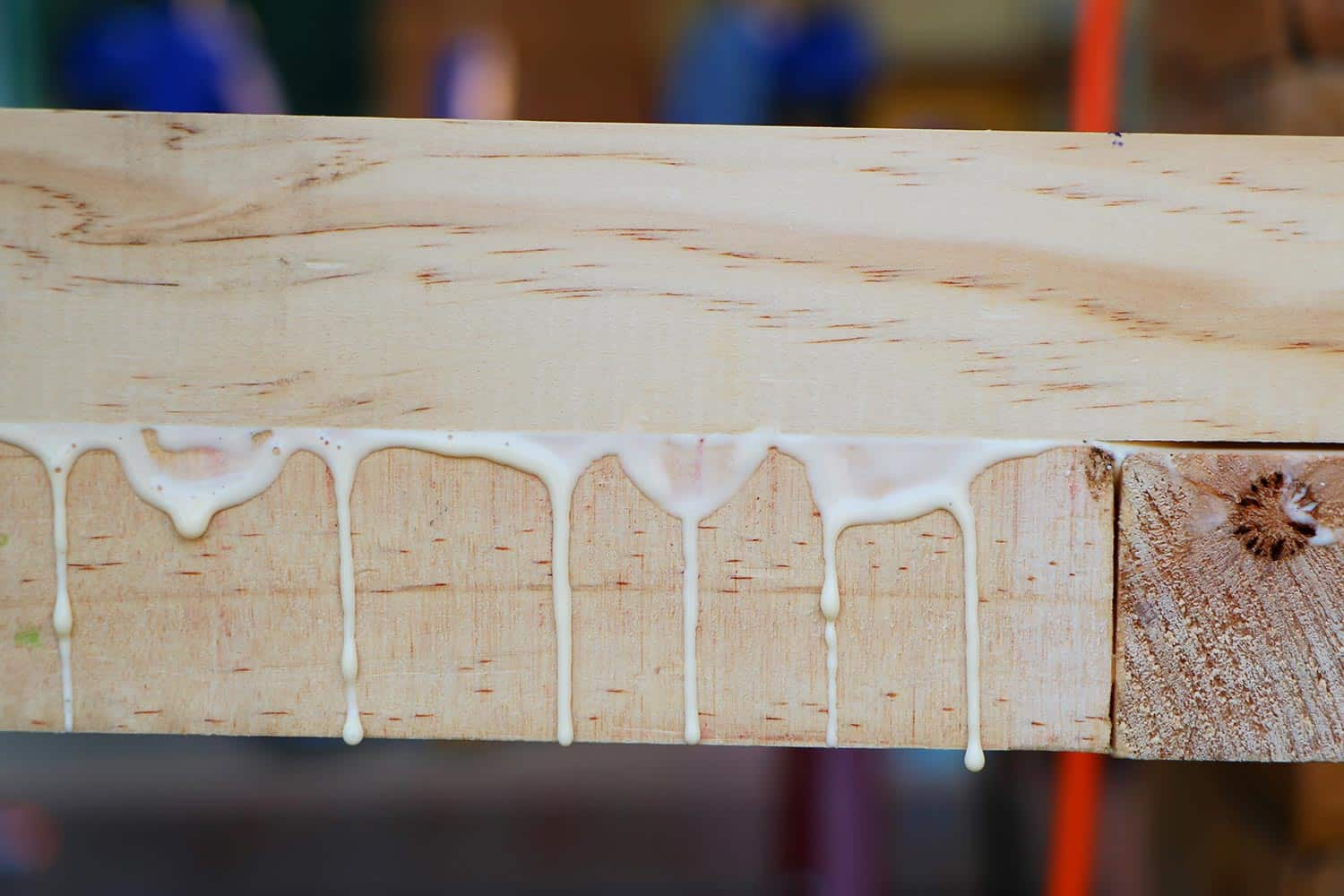 Drops of glue while assembling a new wooden furniture with gluing
