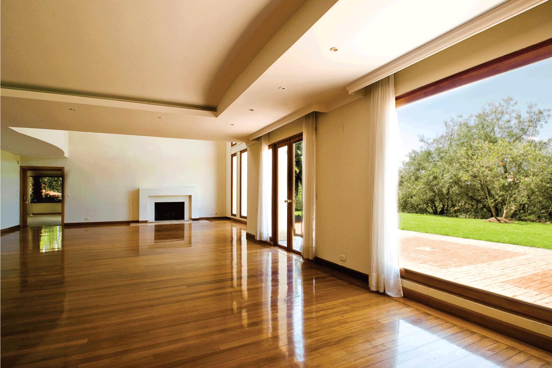 Empty big living room with super shiny waxed wooden floor