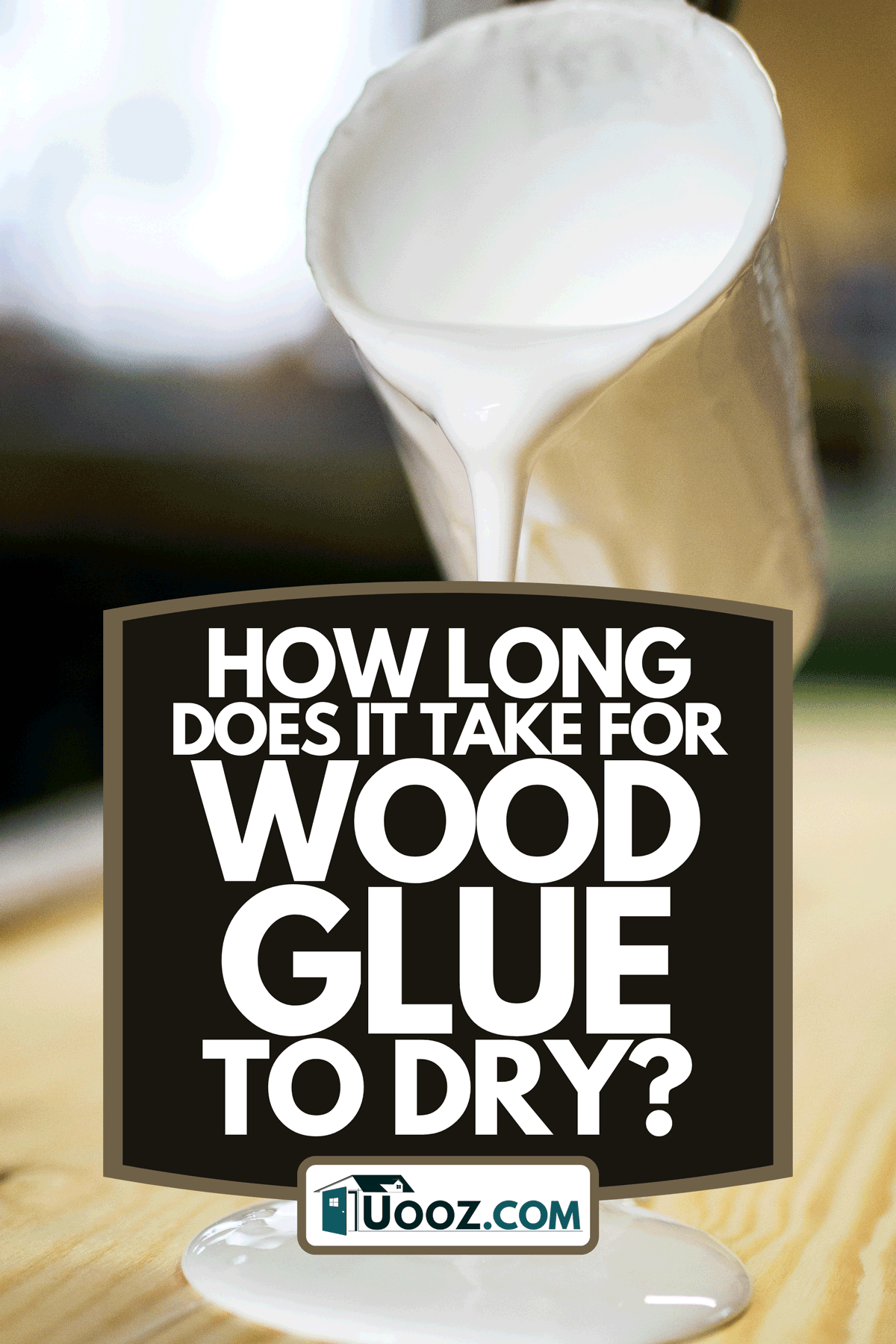 Carpenter uses spatula to distribute glue on a piece of wood in workshop, How Long Does It Take For Wood Glue To Dry?