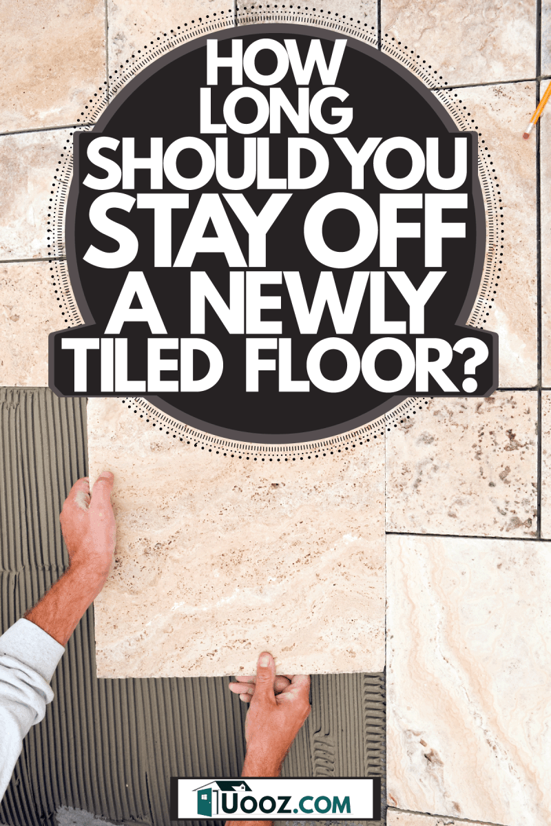 A tile worker properly placing a tile, How Long Should You Stay Off A Newly Tiled Floor?