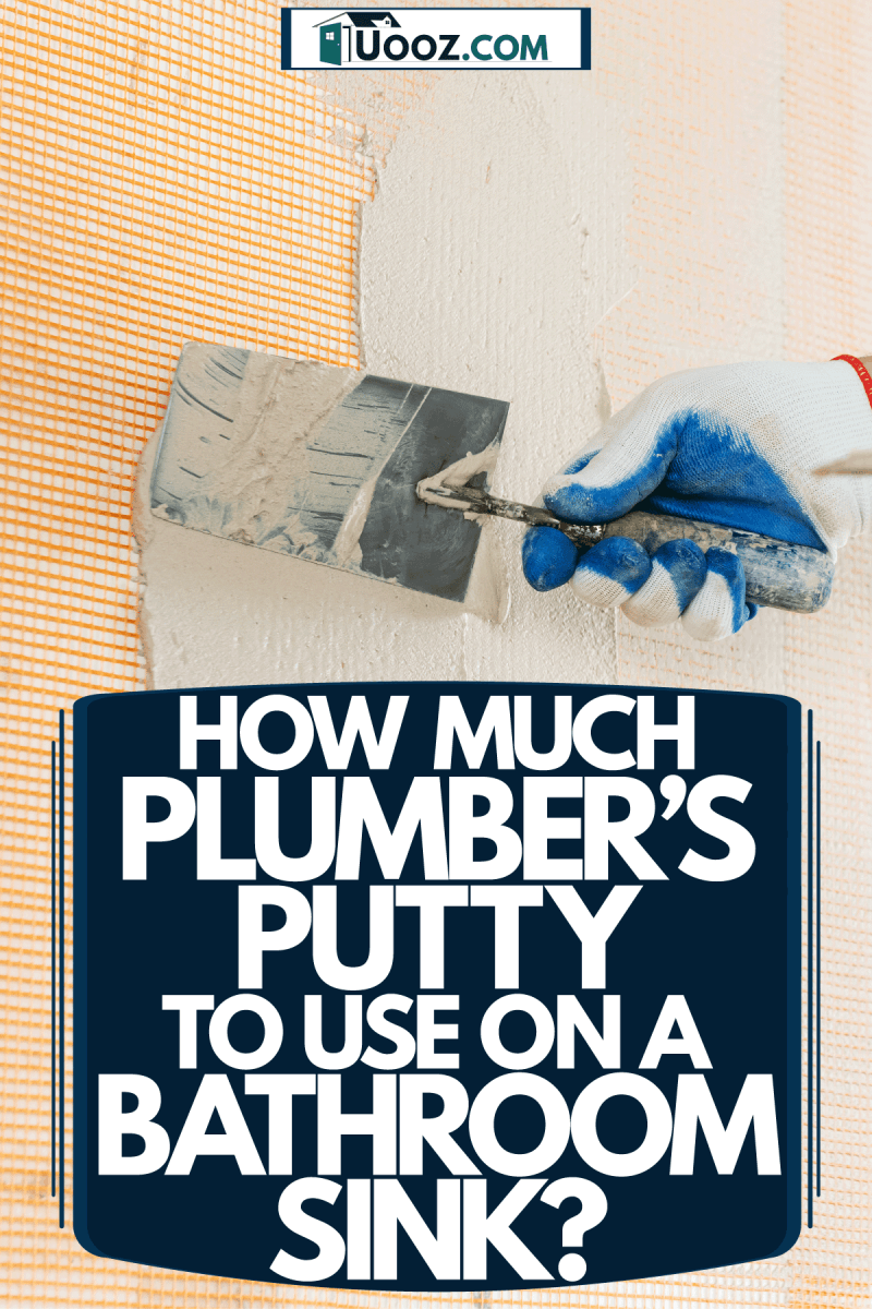A man putting putty on the dry wall, How Much Plumber's Putty To Use On A Bathroom Sink?