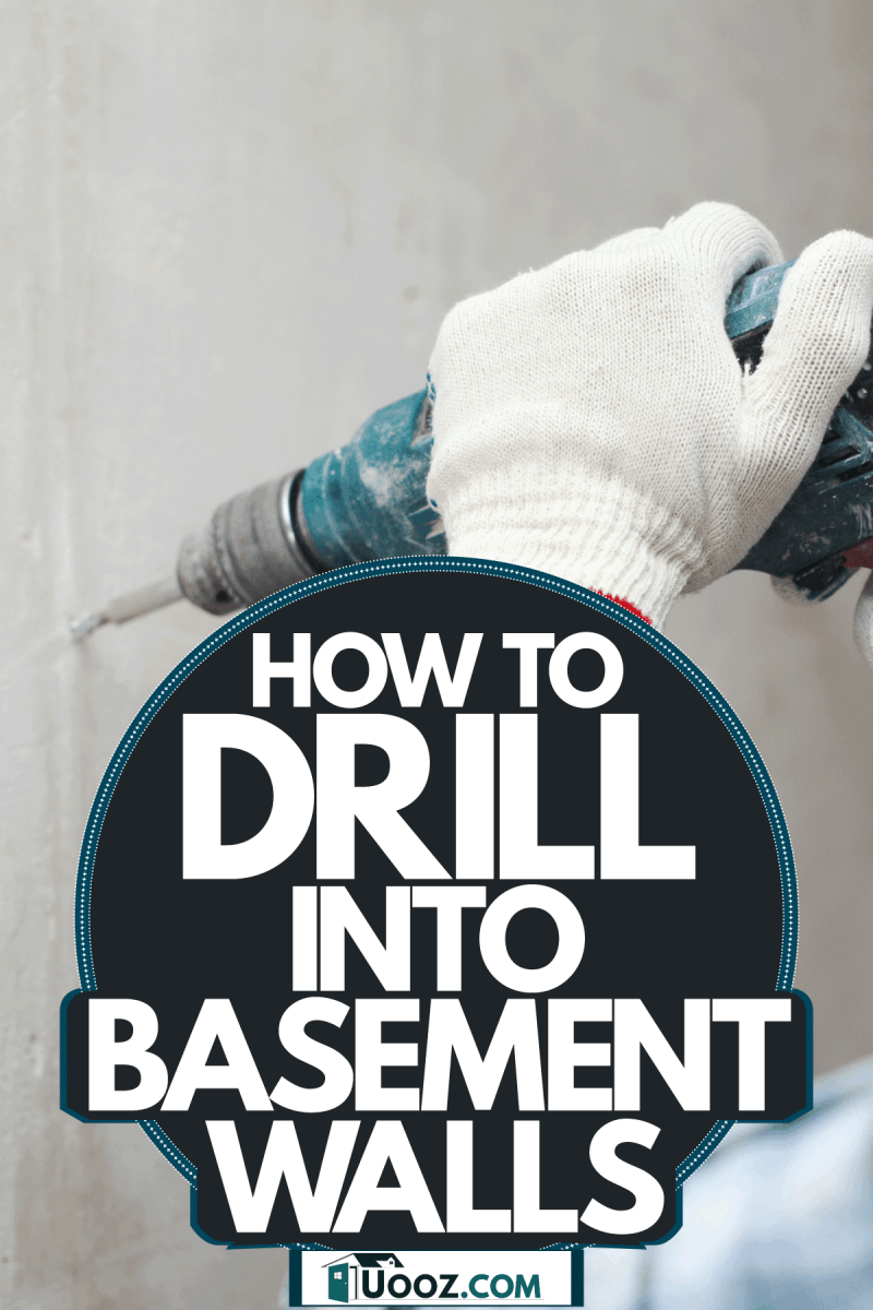 A worker using a hand drill to make holes for the basement, How To Drill Into Basement Walls