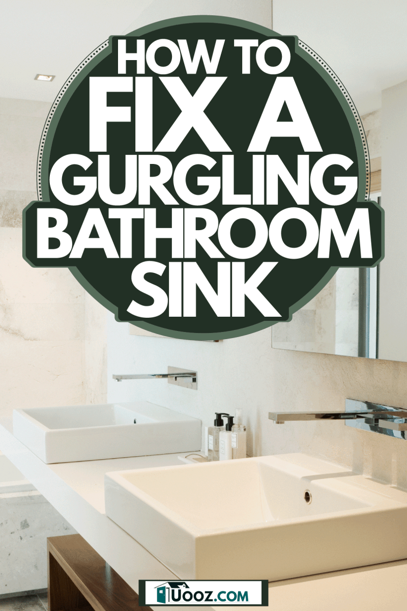 Interior of an elegant and modern bathroom with a modern sink and two huge mirrors, How to Fix A Gurgling Bathroom Sink