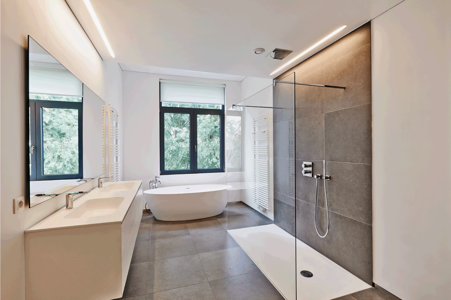 Luxury modern bathroom with glass partitioned shower area