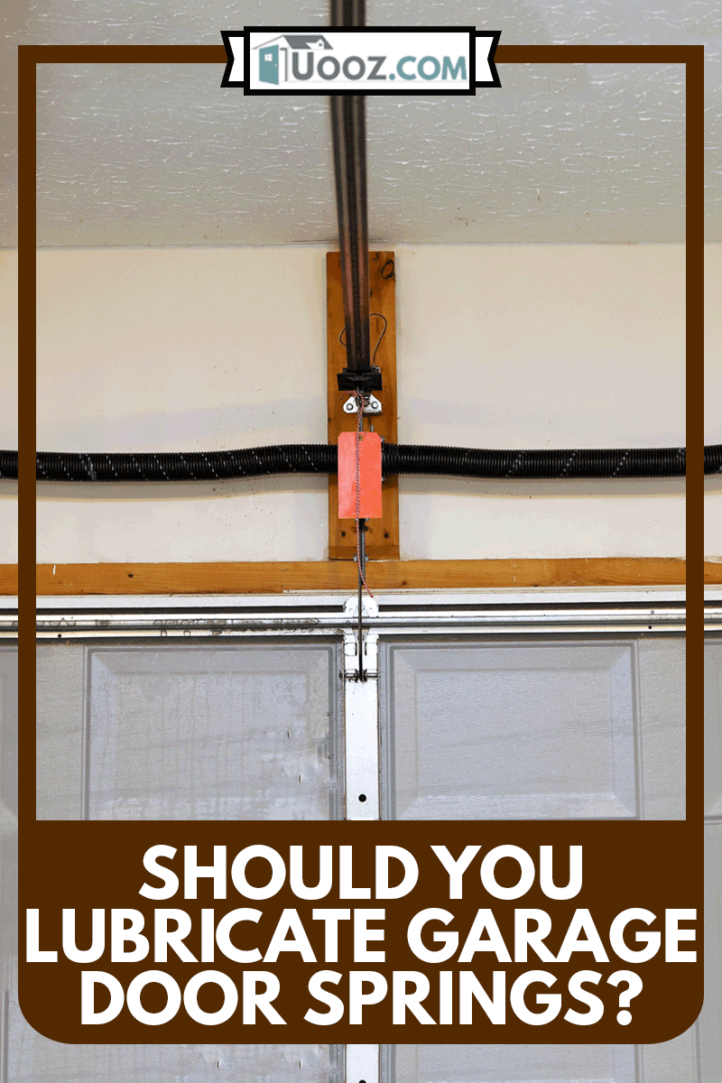 A close up image of a the springs on a overhead garage door opener, Should You Lubricate Garage Door Springs?