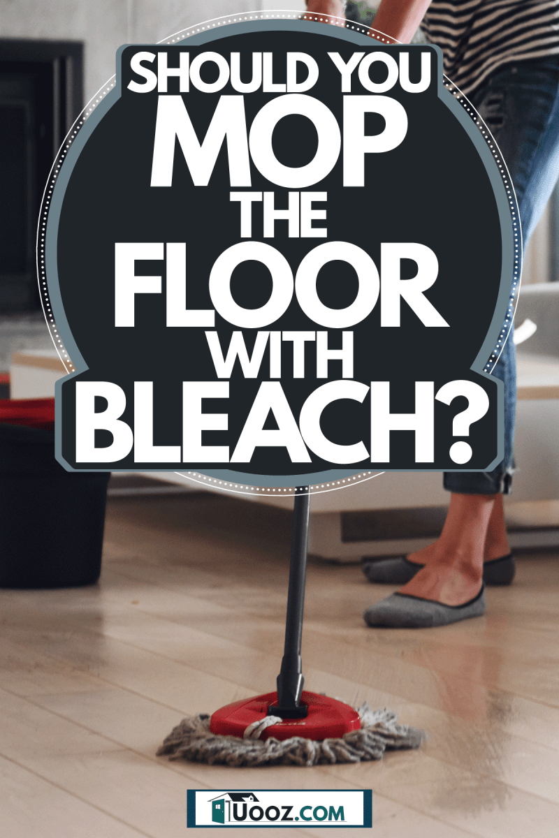 A woman mopping the floor of her living room, Should You Mop The Floor With Bleach?
