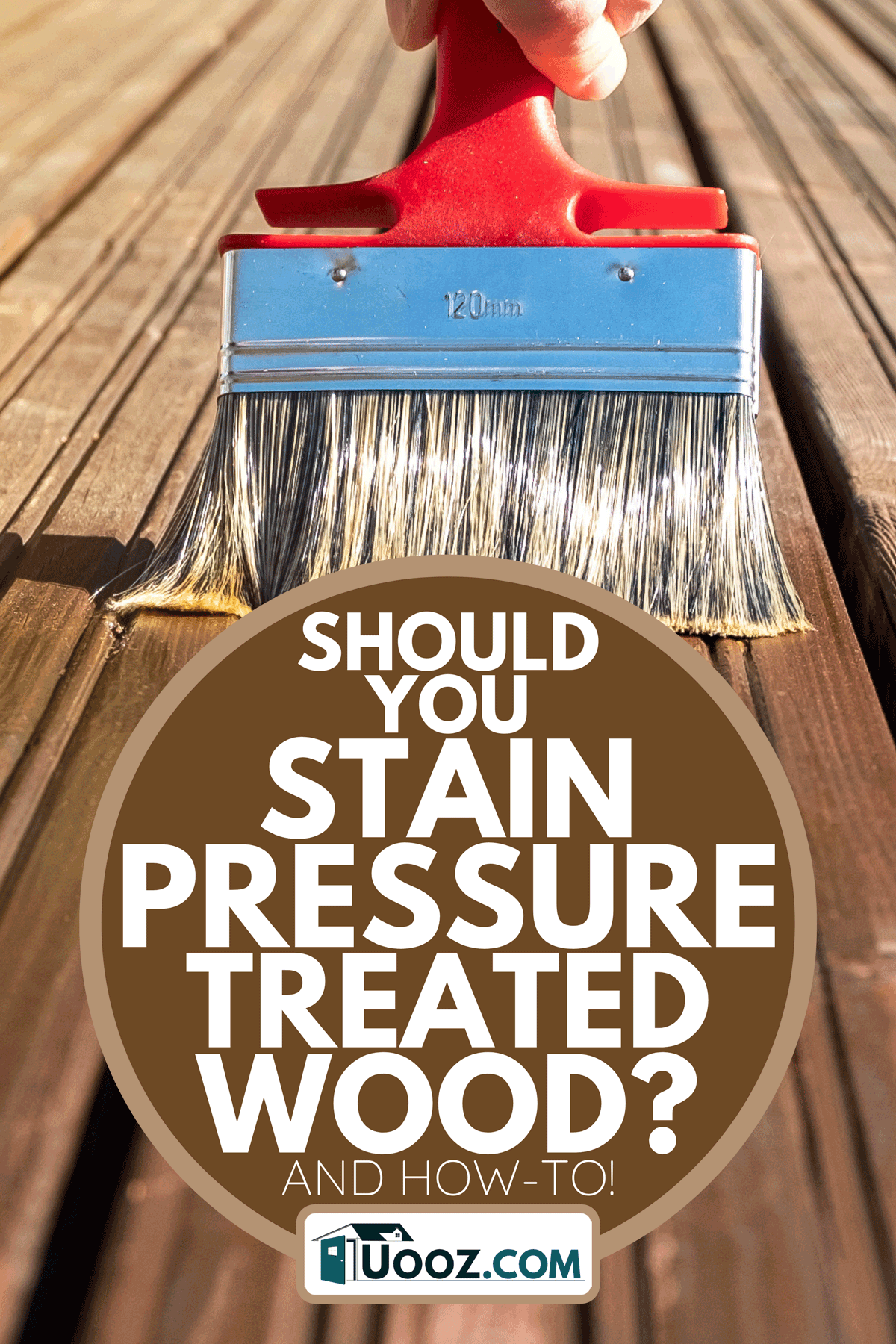 A painter paints the surface of a wooden board with a brush, Should You Stain Pressure-Treated Wood?