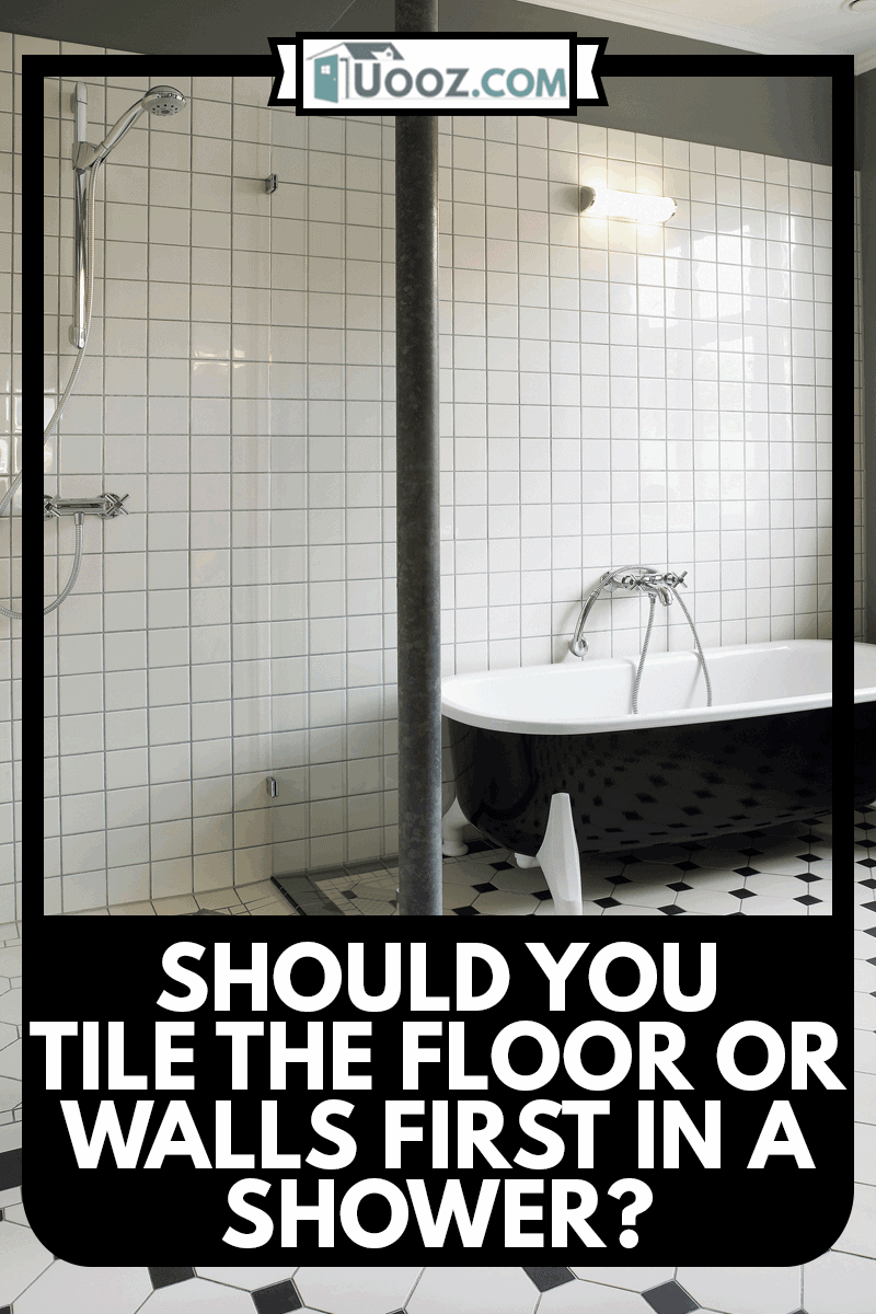 Totally renovated bathroom with shower cabin and bathtub,light cream coloured tiles on floor and wall, Should You Tile The Floor Or Walls First In A Shower?