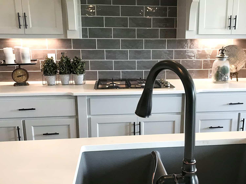 White kitchen sink and cabinets in modern kitchen interior