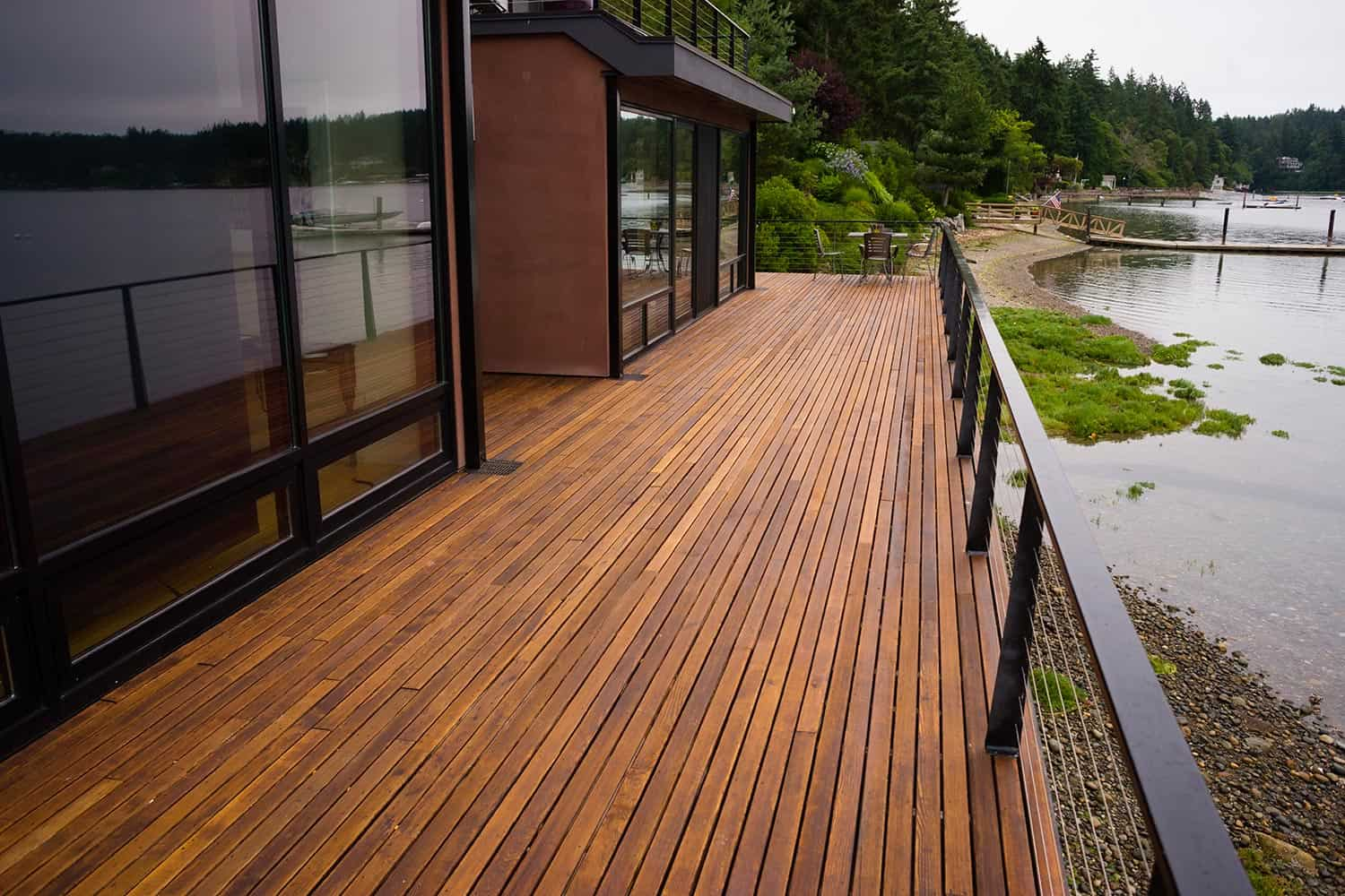 Wood plank deck patio on a contemporary waterfront home