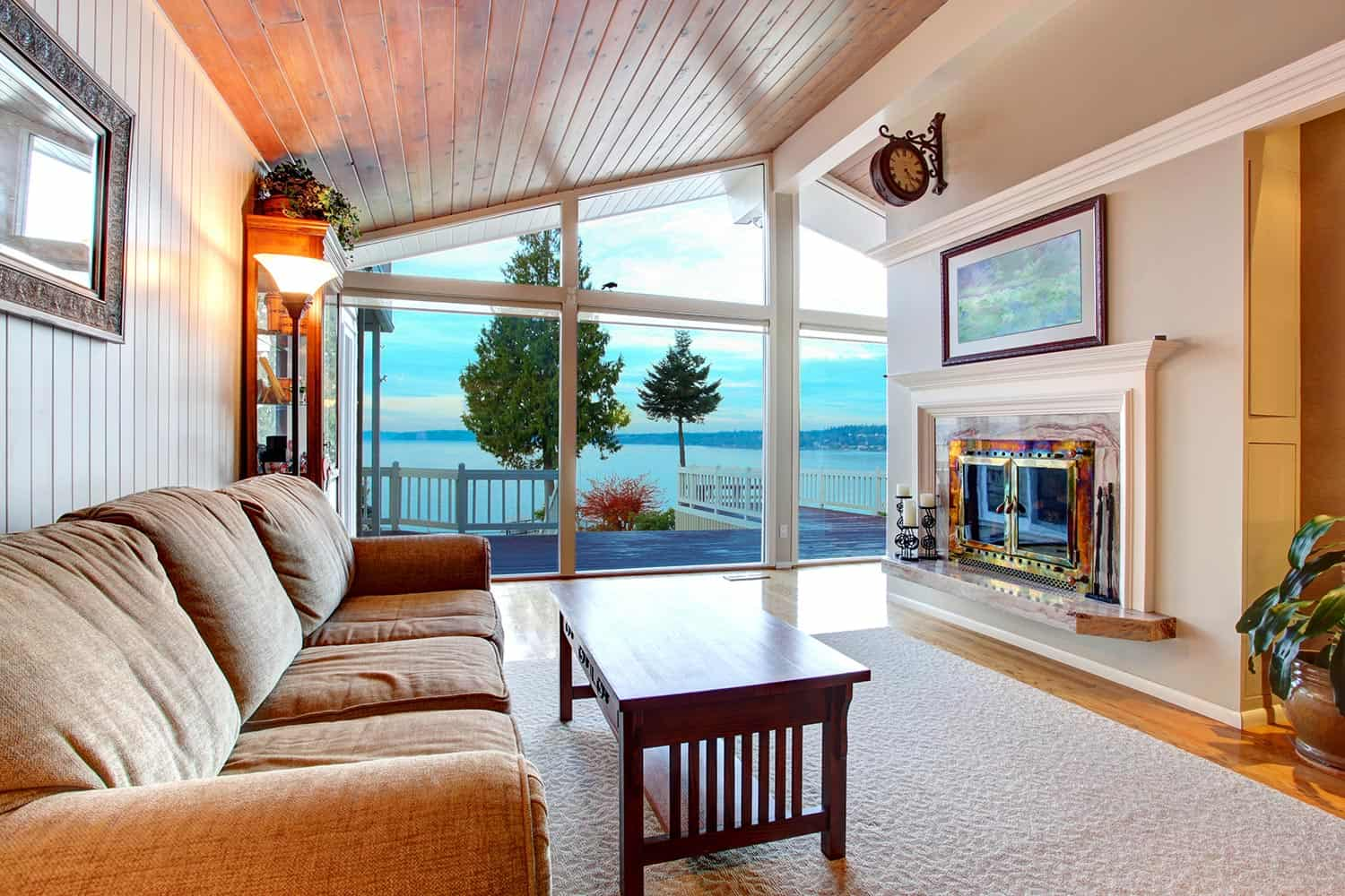 Awesome living room interior with sloped wooden ceiling