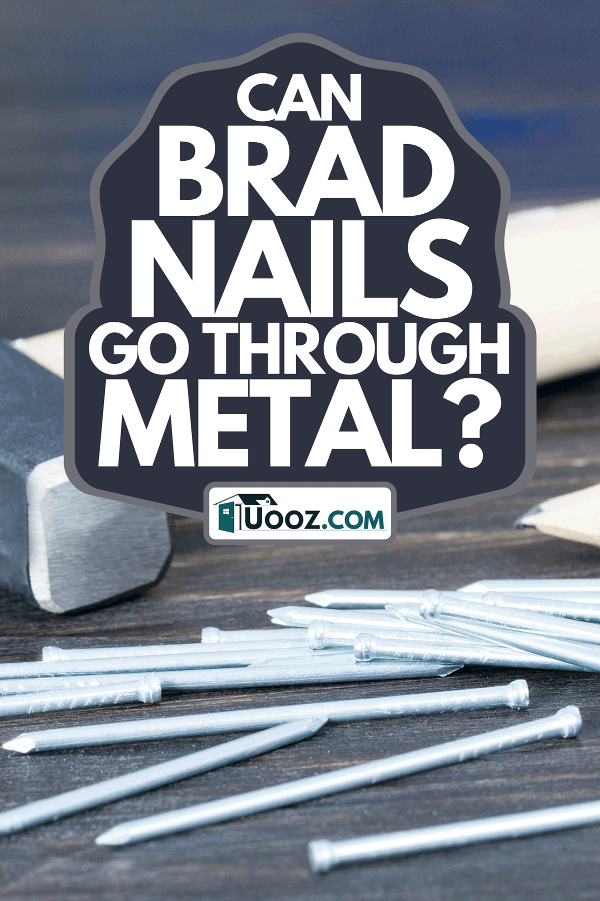 A construction hammer and nails on blackboard background, Can Brad Nails Go Through Metal?