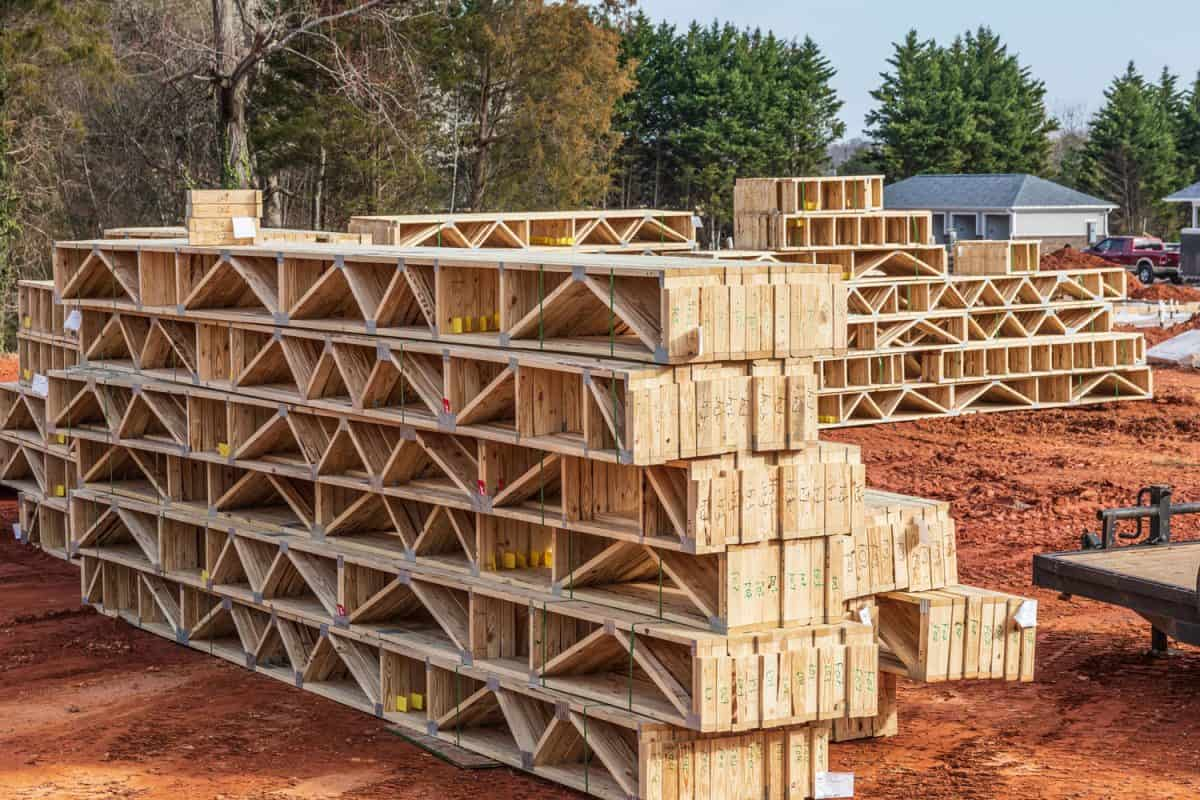 Factory-built floor trusses ready for use in building an apartment building