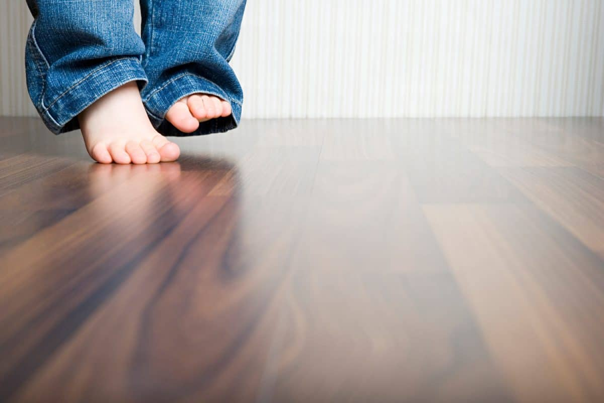 Feet walking on a Hardwood Floor