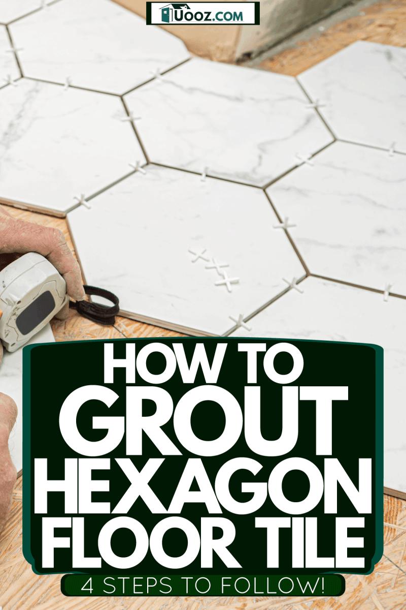 A tile setter placing hexagonal tiles inside a bathroom, How To Grout Hexagon Floor Tile [4 Steps To Follow!]