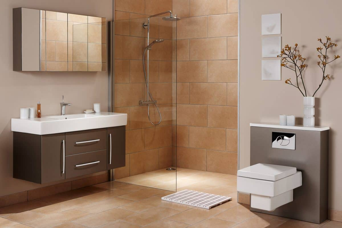 Minimalist contemporary bathroom with brown tile backsplash on the shower area and stainless steel cabinet on the vanity