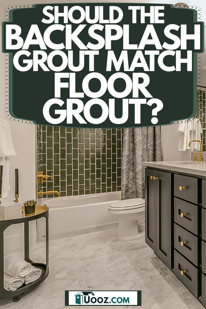 A teal and luxurious bathroom with green cabinetry, green backsplash, and a huge mirror on the vanity, Should The Backsplash Grout Match Floor Grout?