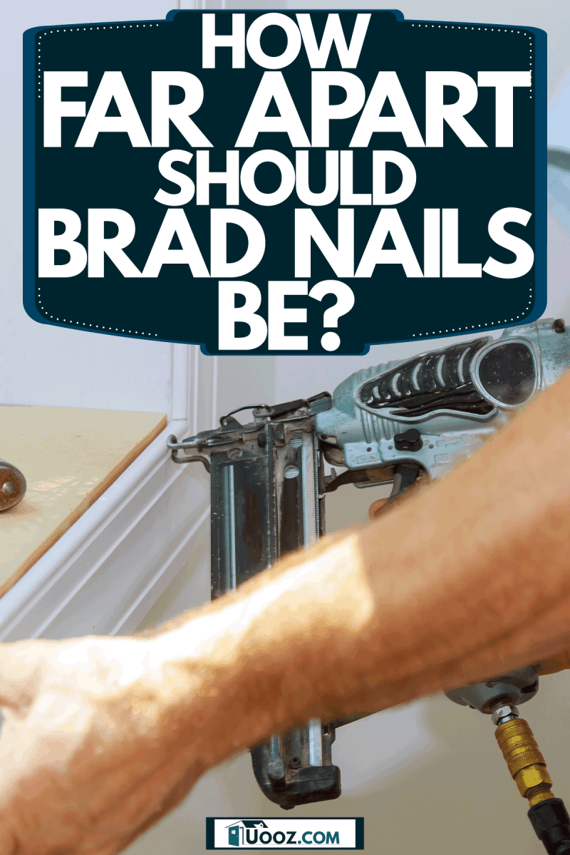 A man using a nail gun to place a trim on the reading nook, How Far Apart Should Brad Nails Be?