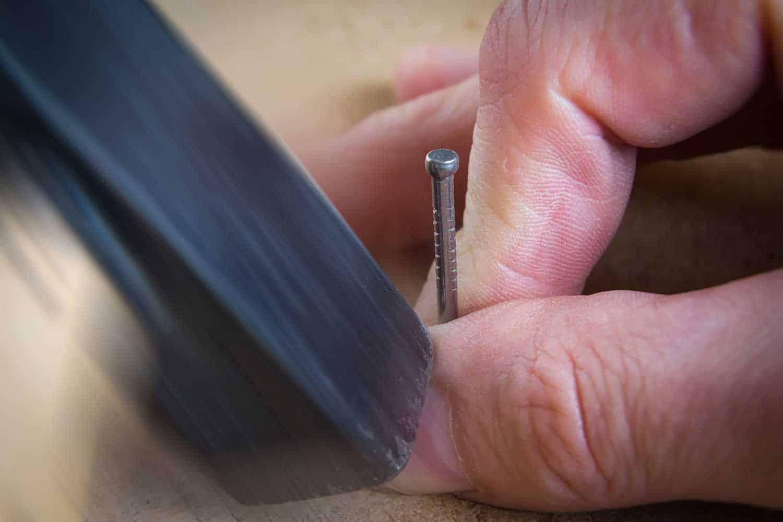 Close up of hammer and nail