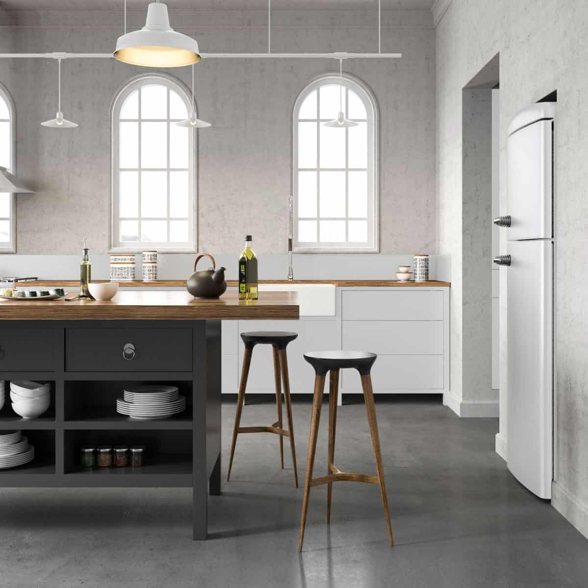 Luxurious interior of a kitchen with white walls, shiny concrete flooring and a wooden countertop kitchen