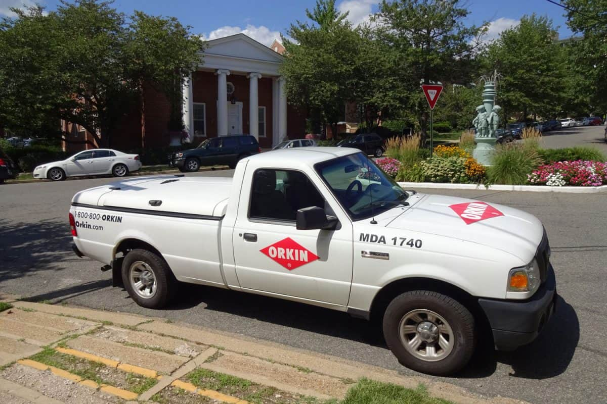 Orkin pest control truck parked on the side of the road