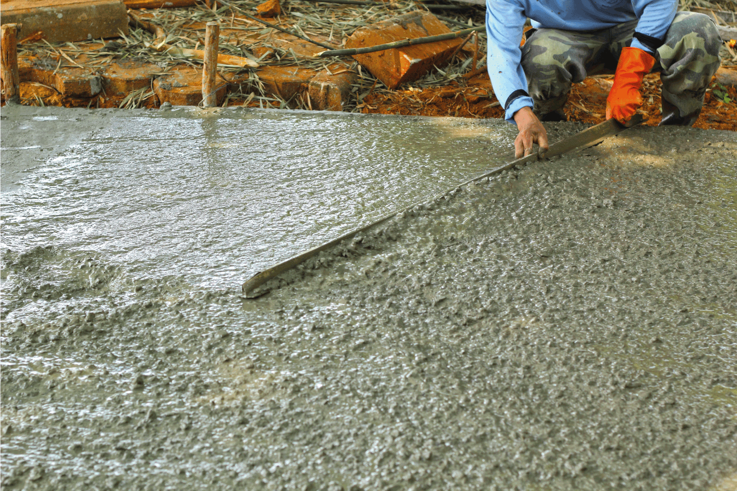 worker levelling poured concrete