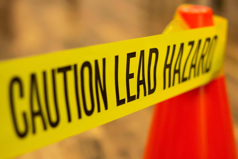 Caution tape describing lead-based paint hazard