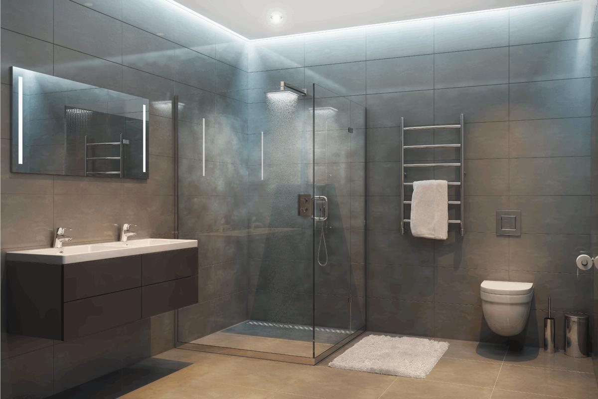 Gray modern shower room in the evening. Should You Tile Under A Shower Base
