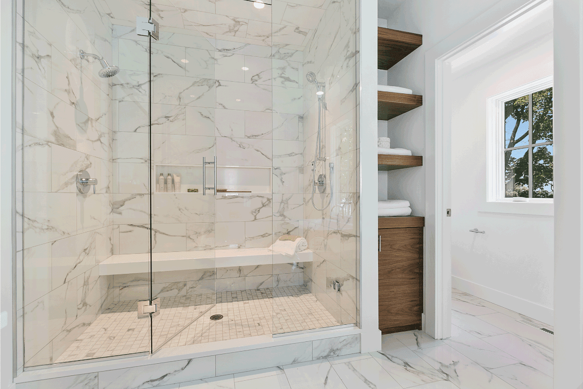 Long bench in shower and full glass entry to shower. How Long Should A Shower Base Last