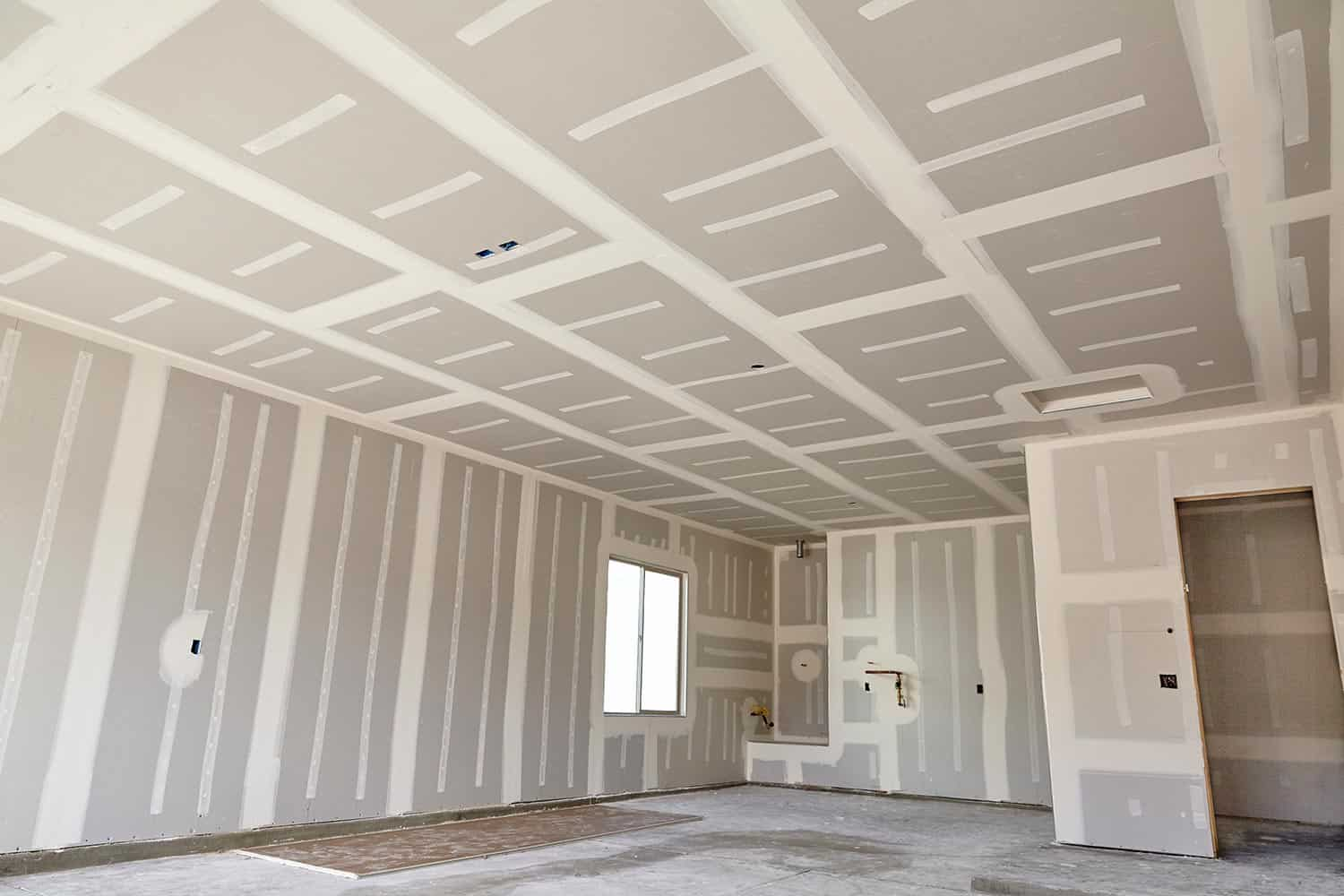 New home construction with drywall tape