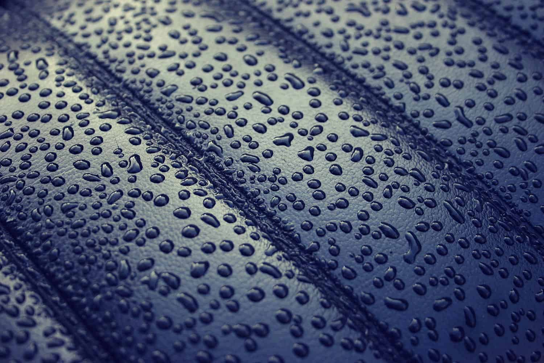Water rain drops on dark leather