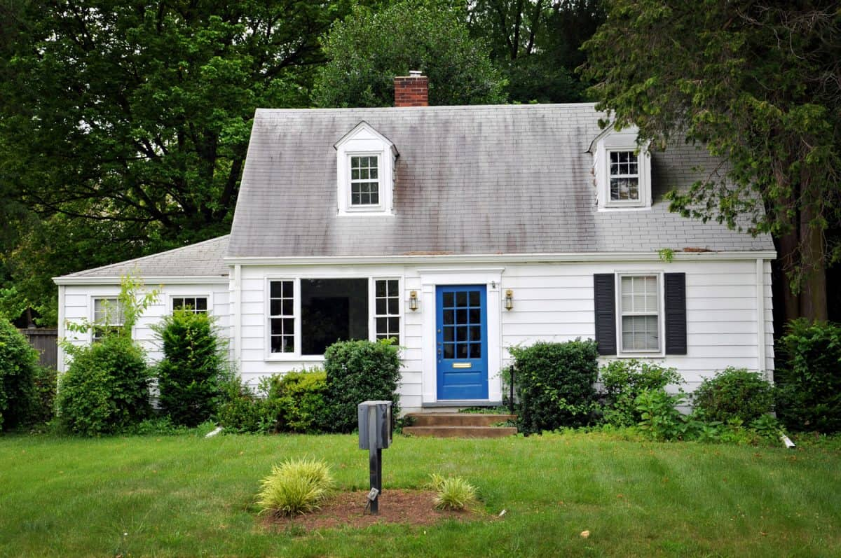 White colored house with blue door