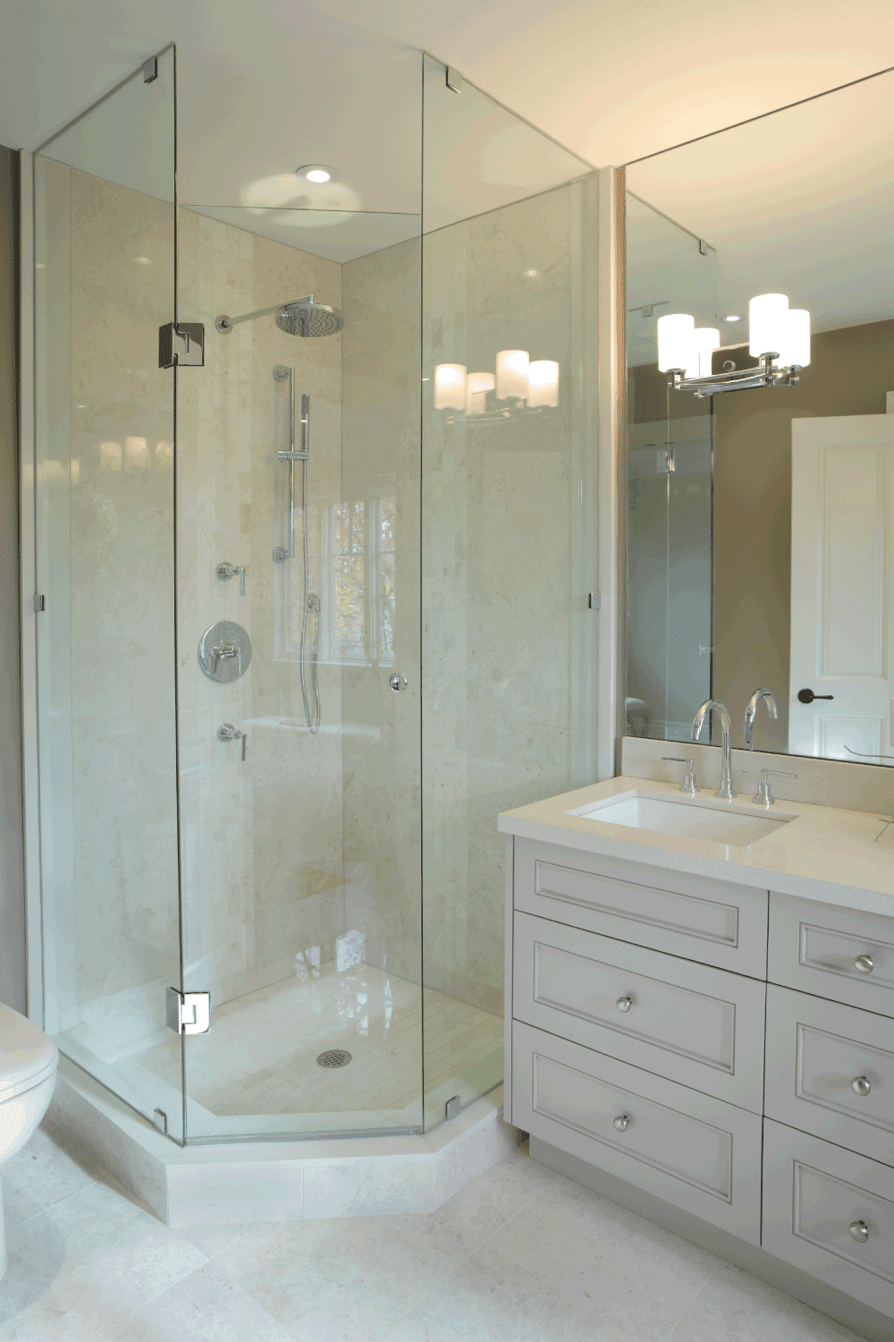luxury bathroom with glass dividers and shower base